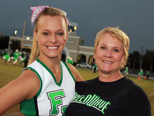 Fort Myers High School track and field coach Sheryl Jones with her daughter Katie in 2011.