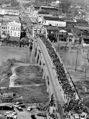This March 21, 1965, file photo shows civil rights marchers crossing the Alabama river on the Edmund Pettus Bridge in Selma, Ala., to the state capital of Montgomery.