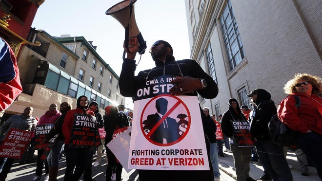 Verizon workers picket outside one of the company's facilities Wednesday, April 13, 2016, in Philadelphia. Verizon landline and cable workers on the East Coast walked off the job Wednesday morning after little progress in negotiations since their contract expired nearly eight months ago. (AP Photo/Matt Rourke)