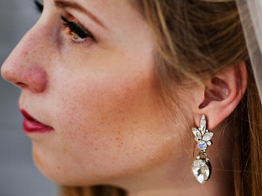 Caitlin Sole, models earrings from Leona Ruby.