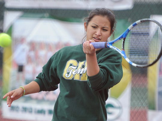 Sisters Jade (pictured) and Jackie Kawamoto play tennis at Greenwood High School. Jackie, the defending state champion has given up the number one spot on the team to her sister to give her a chance to contend for the state title.