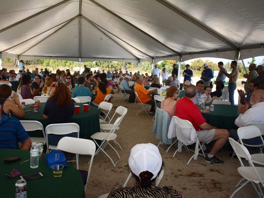 The group in the tent hears from Eric Draper, executive director of Audubon Florida.