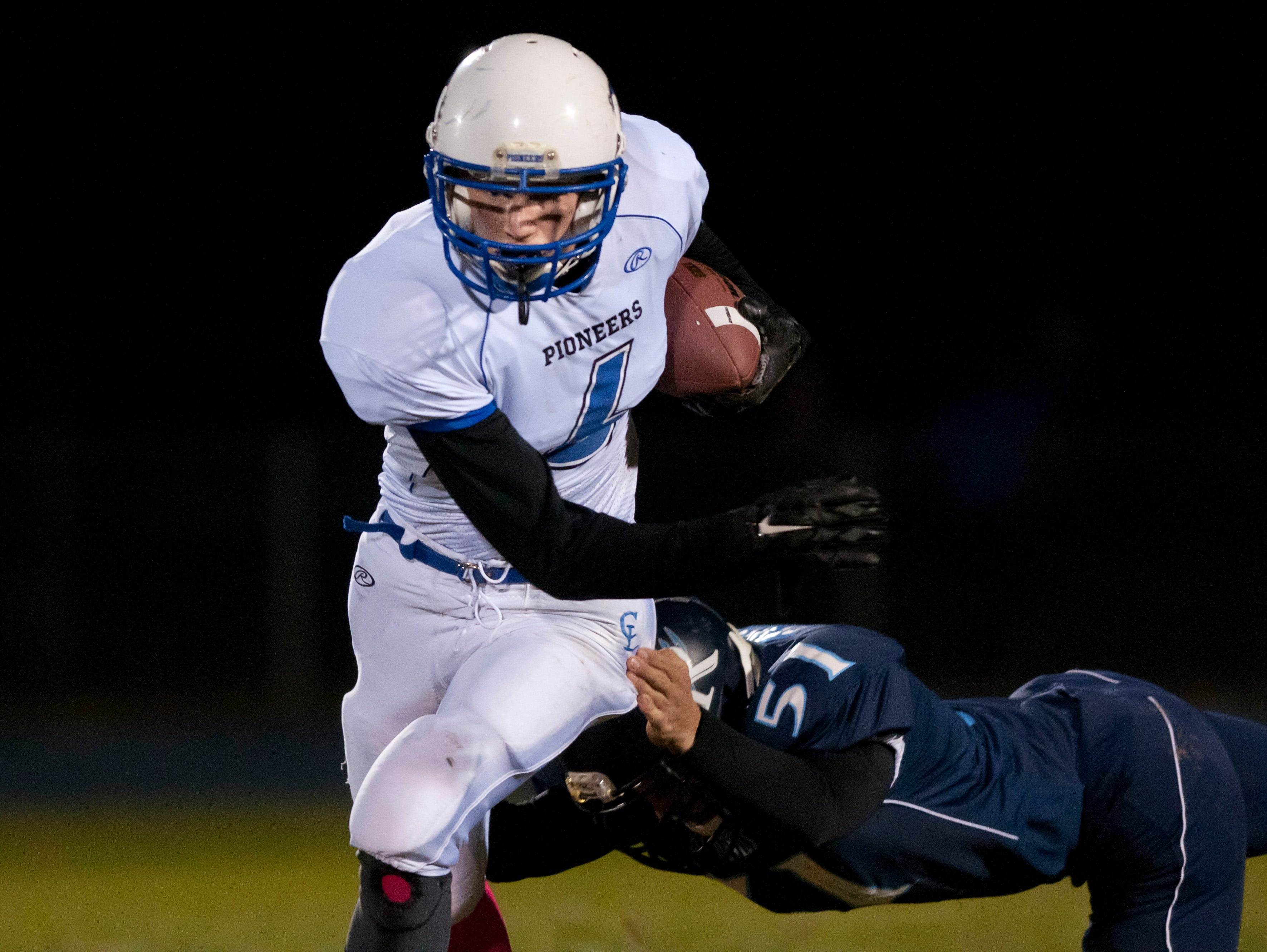 Cros-Lex's Christopher Zielinski runs the ball and breaks a tackle by Richmond's Hunter Bergeon during a football game Friday, October 30, 2015 at Richmond High School.