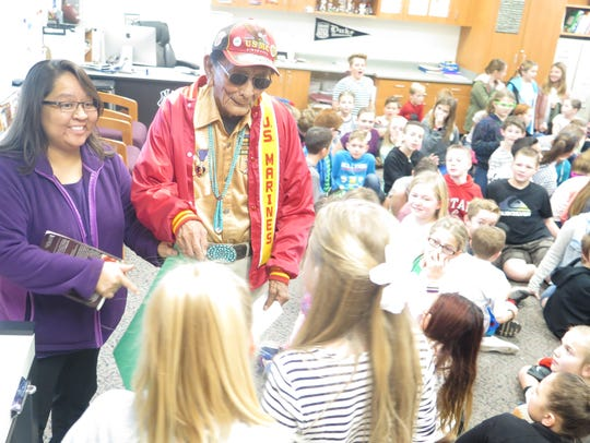 T.J. Bagaii introduces Navajo Code Talker Samuel Tom Holiday to fifth-grade students at Riverside Elementary School in Washington City, Utah, on Feb. 8, 2016.