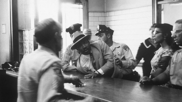 Atlanta police arrest Martin Luther King Jr. and students