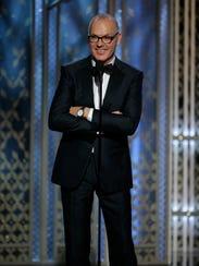 "Michael Keaton accepts a best actor honor for ""Birdman"""