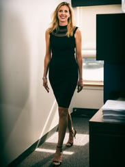 Laura Rowe wearing form fitting, black illusion mesh
