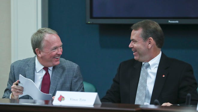 Interim AD Vince Tyra, at right, laughs with interim UofL President Greg Postel before the start of the ULAA meeting Oct. 24.