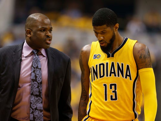 Indiana Pacers coach Nate McMillan talks to forward