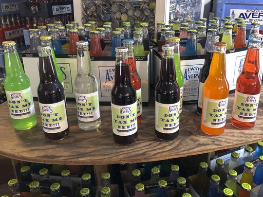 In this Friday, March 29, 2019, photo, bottles of soda at Avery's Beverages are on display at Avery's Beverages in New Britain, Conn., to protest Democratic Gov. Ned Lamont's proposed tax on sugary drinks.