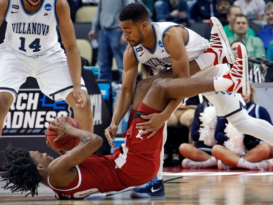 Alabama 's Herbert Jones, bottom, battles Villanova