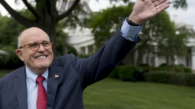 In this Tuesday, May 29, 2018 file photo, Rudy Giuliani, an attorney for President Donald Trump, waves to people during White House Sports and Fitness Day on the South Lawn of the White House, in Washington.
