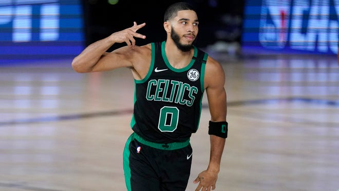 Boston Celtics' Jayson Tatum (0) gestures after scoring against the Miami Heat during the first half of an NBA conference final playoff basketball game, Tuesday, Sept. 15, 2020, in Lake Buena Vista, Fla.