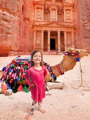 After Krome Photos, this young girl is standing in front of Petra in Jordan.