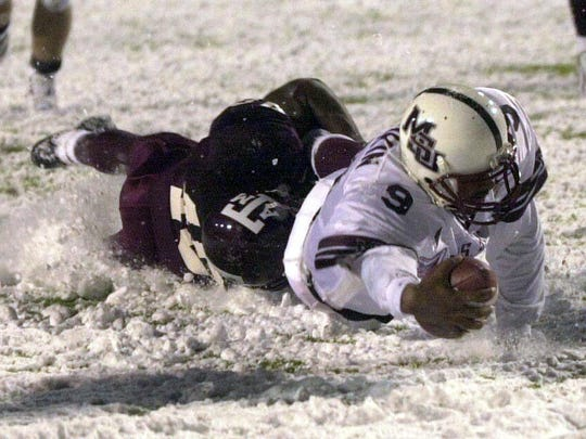 Mississippi State's Wayne Madkin scores the winning touchdown in overtime of the 2000 Independence Bowl against Texas A&M.