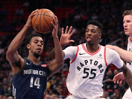 Detroit Pistons guard Ish Smith (14) drives around Toronto Raptors guard Delon Wright (55) during the first half of an NBA basketball game, Monday, April 9, 2018, in Detroit. (AP Photo/Carlos Osorio)