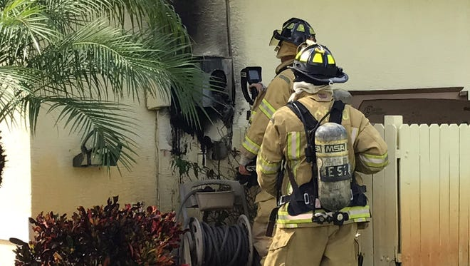 San Carlos Park firefighters examine a utility box that caught fire Tuesday afternoon.
