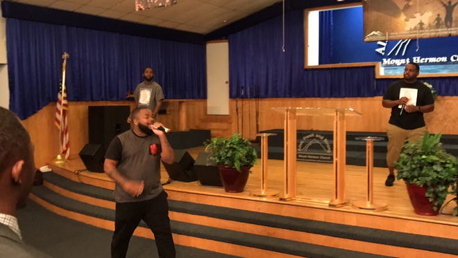 HGM, a Christian rapping trio from St. Mary Missionary Baptist Church in Fort Myers, performed several selections  during the  2017 Dr. MArtin Luther King Jr. ecumenical service Sunday at Mount Herman Church. Singing is Christopher Hardin while his brothers, Kaylon, right, and Jarion, perform on the stage.