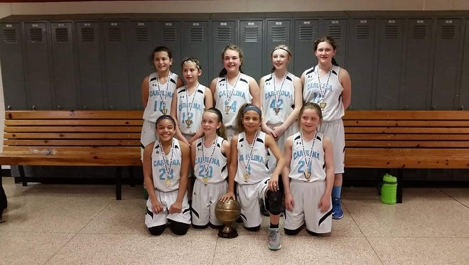 The Team Carolina fifth-grade girls were the first-place team in the silver bracket of last weekend's Mayberry March Madness basketball tournament.