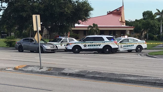 Several Lee County Sheriff's Office units, surrounding a gray sedan on Lee Boulevard, were part of a second crime scene related to a fatal shooting in Lehigh Acres on Thursday morning. Several of the units showed significant damage.