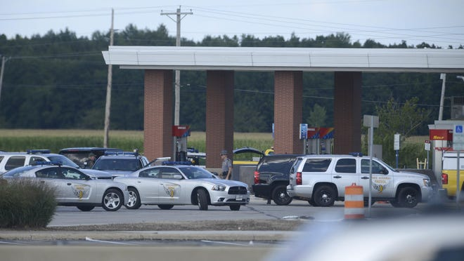 The Ohio Highway Patrol searches Erie Island Plaza on Tuesday for a suspect in a double shooting in Alliance.