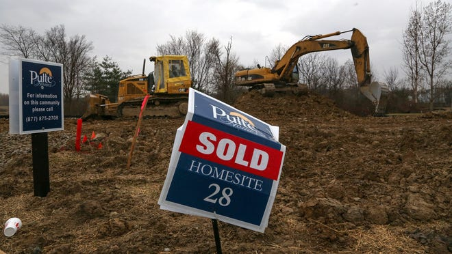 Realcomp multiple listing service reports that home sale prices were 14% higher in December in metro Detroit. The number of sales were flat.