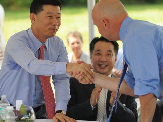 Hong-Hulk Kim, chairman of Harim Group, shakes hands