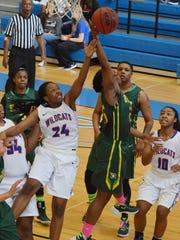 Louisiana College's Taylor Payne (24, left) and Belhaven's Jacinda Smith (25, right) go after a rebound Saturday.