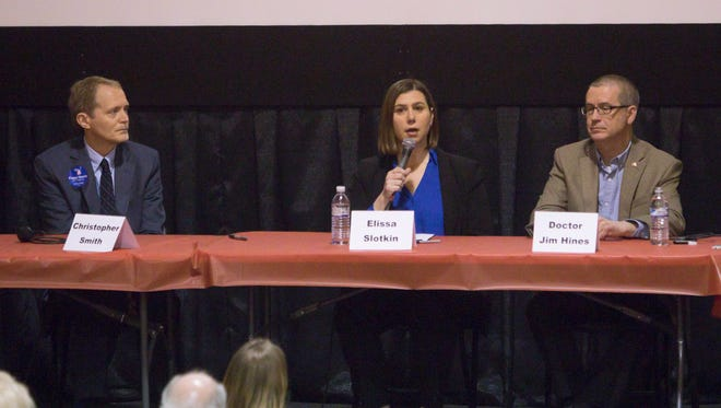 Speaking in a on town hall forum on gun violence Saturday, April 7, 2018, from left, 8th District Congress candidates Christopher Smith and Elissa Slotkin, and candidate for Michigan governor Dr. Jim Hines responded to questions from moderator Rob Osterman as well as from the audience at the Historic Howell Theater.