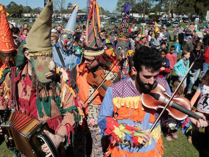 Musicians lead a traditional Courir de Mardi Gras for