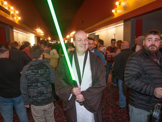 Matt Waldt of Medford wears an Obi-Wan Kenobi costume as he arrives to the AMC Loews Theater in Cherry Hill to view 'Star Wars: The Force Awakens' Thursday evening.  12.17.15