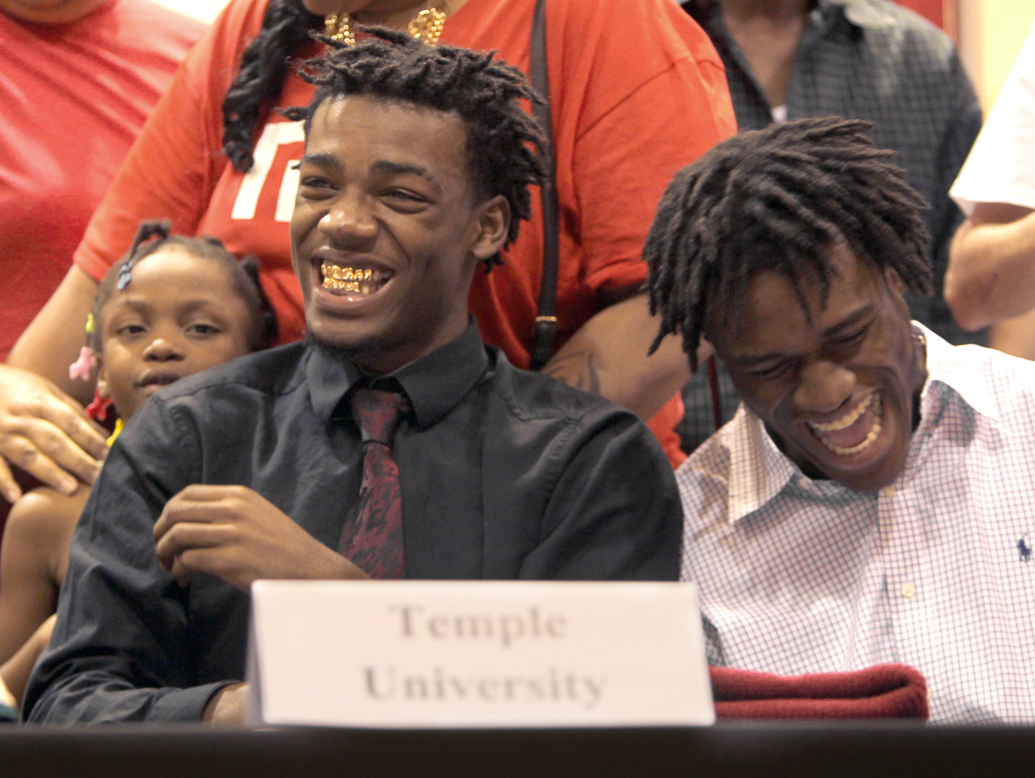 North Fort Myers football players Freddie Johnson, left, and Austin Watkins share a laugh after signing their letters of intent to attend Temple (Johnson) and Dodge City (Watkins) Wednesday during National Signing Day.