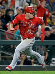 Mike Trout scores on a Mariners error during the ninth