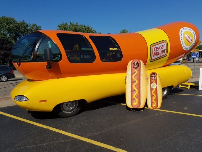 Helen and Thomas Bush pose for a photo with the Wienermobile