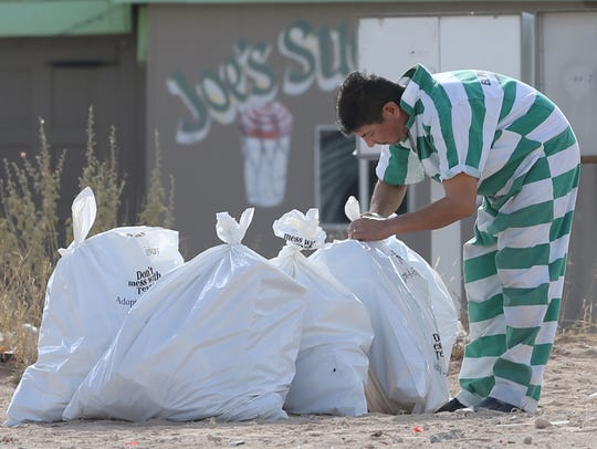 Bags of Fourth of July debris are readied for pickup