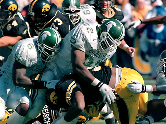 MSUs Sorie Kanu (6) and Reggie Garnett (22) tackle