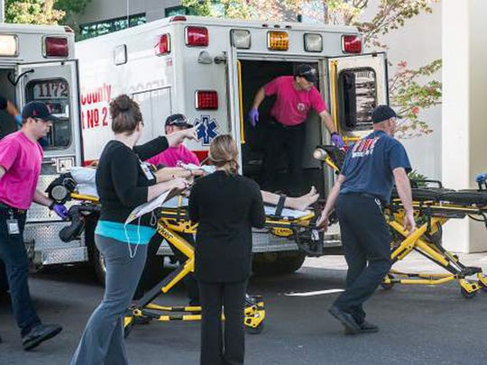 A patient is wheeled into the emergency room at Mercy