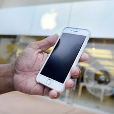 Josh Nolan holds his new iPhone 6 at an Apple Store in Augusta, Ga., on Friday.