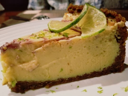 Illuminati's house-made key lime pie with 2-inch-thick filling and a crust of pecans and graham crackers.
