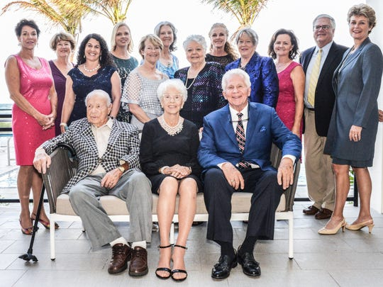 Representing The Library Foundation of Martin County are, seated, from left, Pres Blake, Helen Blake, and Frank M. Byers Jr.; standing, from left, Karen Rodgers, Joan Amerling, Stacy Ranieri, Christine DelVecchio, Noreen Fisher, Widget Webert, May Smyth, Denise Ehrich, Meg Bradley, Debbie Sopko, Jim Sopko, and Leigh Garry.