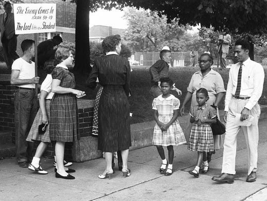First graders Patricia Guthrie, left, with her mother,