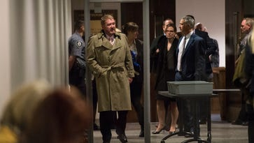 Dan King, the lead public defender for Robert Dear, Jr., leaves the courtroom during a lunch break in the competency hearing for Dear, Thursday, April 28, 2016, in the El Paso Country Judicial Building in Colorado Springs, Colo. Dear is charged with murder in the Planned Parenthood attack Nov. 27, 2015. (Christian Murdock/The Gazette via AP, Pool)