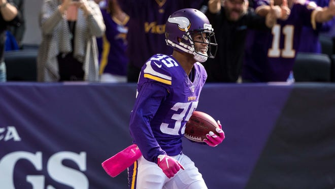 Marcus Sherels, now with the New Orleans Saints, celebrates a punt return for a touchdown for the Minnesota Vikings last season.