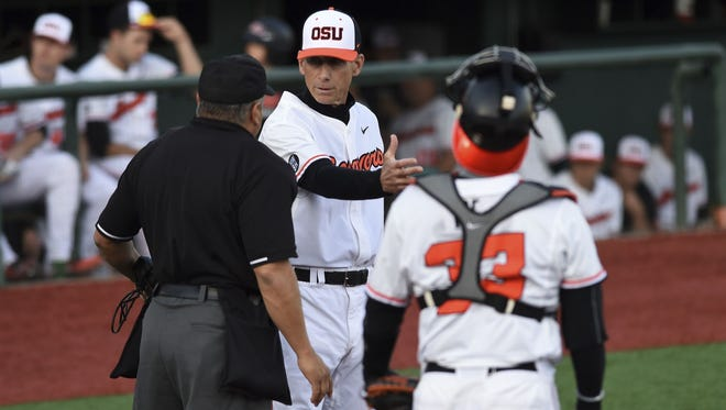 Oregon State coach Pat Casey, center, disagrees with a call during the third inning against Central Arkansas.