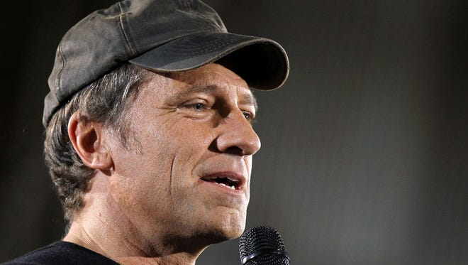 Television personality Mike Rowe looked similar to a  bank robbery suspect.