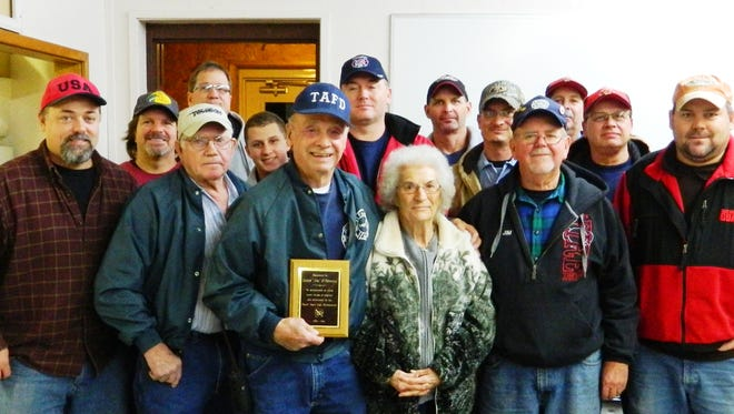 Tracy Area Volunteer Fire Department firefighter James O'Donnell (first row, left) is shown at his recent retirement celebration and dinner. O'Donnell is retiring from the department after 24 years and 2 months of dedicated service to the residents of the Tracy Area Fire Protection District. He was presented with an engraved gold watch and a plaque designating him as Firefighter of the Year for 2014. His wife, Wanda, is shown with him, as are members of the fire department.