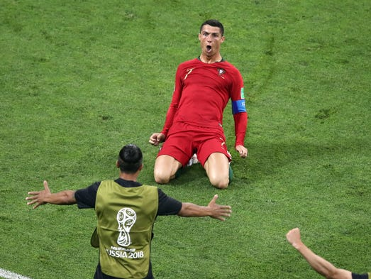 Portugal's Cristiano Ronaldo slides on his knees after