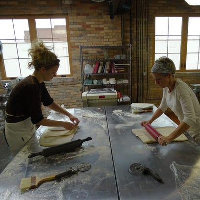Betsy Skrobot and Carly Ringenberg prepare dough for
