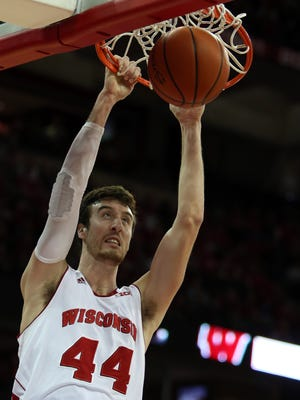Wisconsin Badgers forward Frank Kaminsky (44) dunks the ball during the game with the Iowa Hawkeyes  at the Kohl Center.