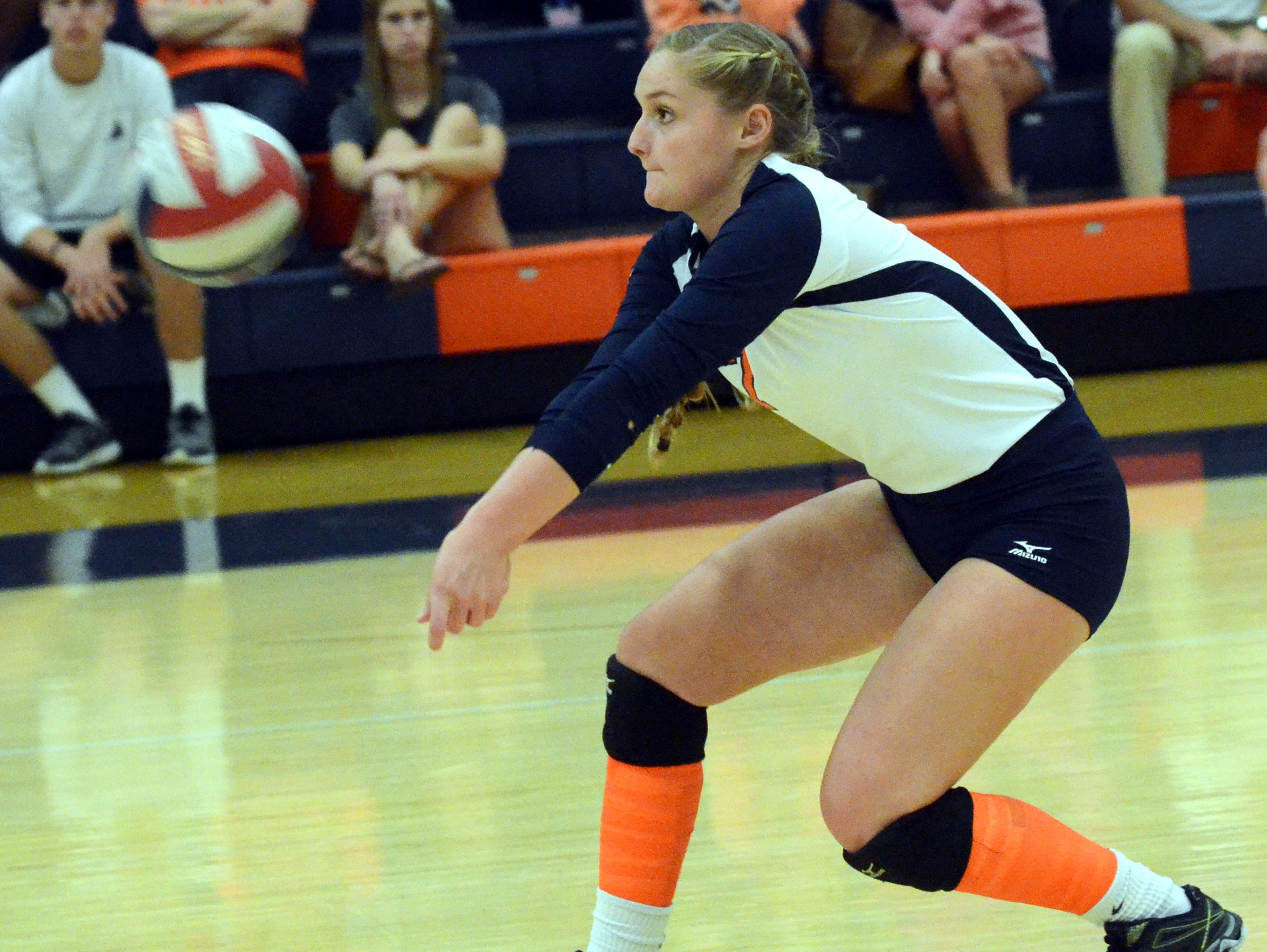 Beech High sophomore Chloee McDaniel passes a serve during the first game.